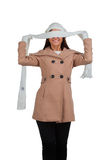 Woman in outrwear, white scarf and hat Royalty Free Stock Photo