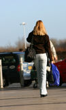 Woman outside Airport Stock Images
