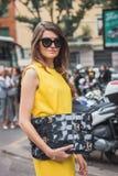 Woman outside Armani fashion shows building for Milan Women's Fashion Week 2014 Royalty Free Stock Image