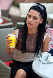 Woman in outside bar. Woman with orange juice in outside bar stock image