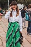 Woman outside Cavalli fashion shows building for Milan Women's Fashion Week 2014 Stock Photography