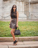 Woman outside Cavalli fashion shows building for Milan Women's Fashion Week 2014 Royalty Free Stock Photography