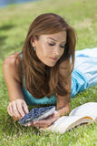 Woman Outside Eating Blueberries & Reading Book Royalty Free Stock Photos