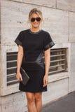 Woman outside Ferragamo fashion shows building for Milan Women's Fashion Week 2014 Stock Photos