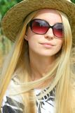 Woman Outside in Hat an Sunglasses Stock Photo