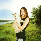 Woman outside holding Husky dog puppy Royalty Free Stock Photo