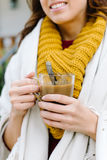 Woman outside home drinking coffee on autumn Stock Photos