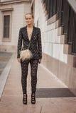 Woman outside Marco De Vincenzo fashion shows building for Milan Women's Fashion Week 2014 Stock Images