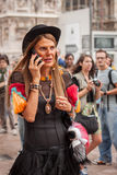 Woman outside Marco De Vincenzo fashion shows building for Milan Women's Fashion Week 2014 Stock Photo