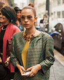 Woman outside Missoni fashion shows building for Milan Women's Fashion Week 2014 Royalty Free Stock Image