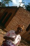 A woman outside Ntarama Church, Rwanda. Stock Photo