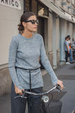 Woman outside Trussardi fashion shows building for Milan Women's Fashion Week 2014 Royalty Free Stock Images