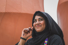 Woman outside United Arab Emirates pavilion at Expo 2105 in Mila. MILAN, ITALY - MAY 19: Woman working for United Arab Emirates pavilion at Expo, universal Royalty Free Stock Photo