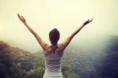 Woman with outstretched arms enjoying the view Stock Photos