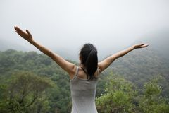 Woman with outstretched arms enjoying the view Royalty Free Stock Photo