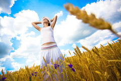 Woman with outstretched arms is enjoys summer day Royalty Free Stock Photo