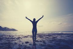 Free Woman Outstretched Arms Reaching The Sky At Sunrise On The Seaside Reef Royalty Free Stock Image - 133530416
