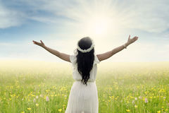 Woman with outstretched hands on meadow Stock Photo