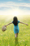 Woman with outstretched hands walks at field Stock Photography