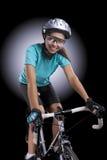 Woman over a bike in studio location Stock Photo