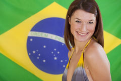 Woman over brazilian flag Stock Image