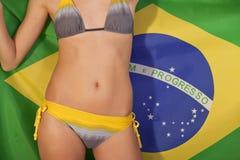 Woman over brazilian flag Stock Image