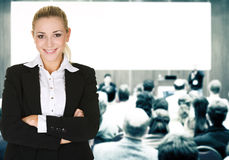 Woman over conference hall Royalty Free Stock Photos