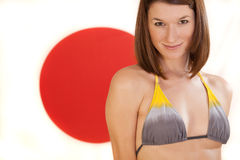 Woman over japan flag Royalty Free Stock Photo