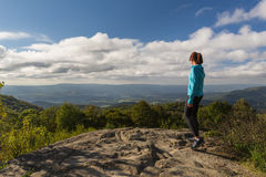 Woman over looking the Blue Ridge Mountains after reaching the p Royalty Free Stock Photography