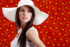 Woman over red flowers wall Stock Images