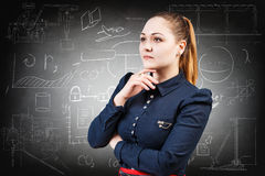 Woman over school chalk board background. Thoughtful woman over school chalk board background Royalty Free Stock Image