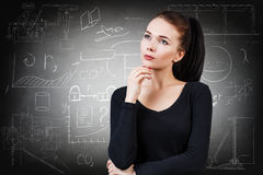 Woman over school chalk board background Royalty Free Stock Photography