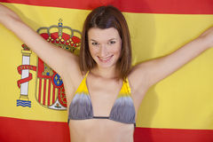 Woman over spanish flag Royalty Free Stock Images