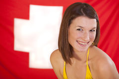 Woman over swiss flag Royalty Free Stock Image