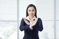 Woman over white background Rejection expression crossing arms doing negative sign, angry face.  royalty free stock image