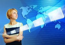 Woman over world map sending email message Stock Photography