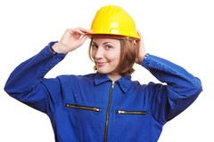 Woman with overall putting on helmet Royalty Free Stock Photo