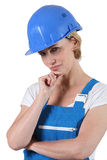 Woman in overalls Stock Image