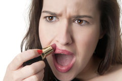 Woman overdrawing her lipstick out of her lips Stock Images