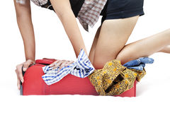 Woman with overfilled suitcase Stock Images