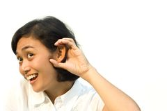 Woman overhear conversation. Portrait of young woman overhear a conversation isolated on white Stock Photo