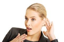 Woman overhearing a conversation Stock Photos