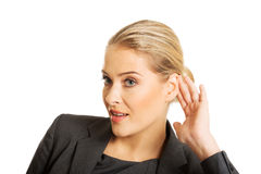 Woman overhearing a conversation Royalty Free Stock Image