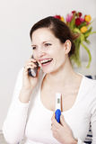Woman overjoyed with positive pregnancy test Stock Images