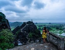 A woman overlooks the mountains of northern Vietnam from Hang Mua, a popular hiking destination. Asia royalty free stock image