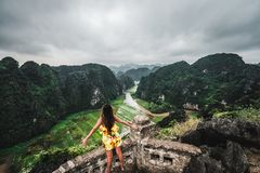 A woman overlooks the mountains of northern Vietnam from Hang Mua, a popular hiking destination. Asia royalty free stock photo
