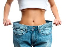 Woman in oversize jeans after weight loss. Woman in oversize jeans after weight loss, diet concept Royalty Free Stock Image