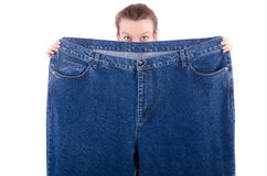 Woman with oversized jeans in dieting concept Royalty Free Stock Photo