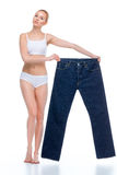 Woman with oversized jeans Stock Photos
