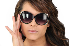 Woman in oversized sunglasses Stock Images
